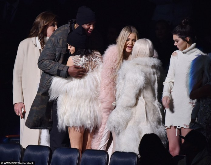 Catching up: Lamar embraced Kylie upon arriving at the show and looked thrilled to see his former in-laws