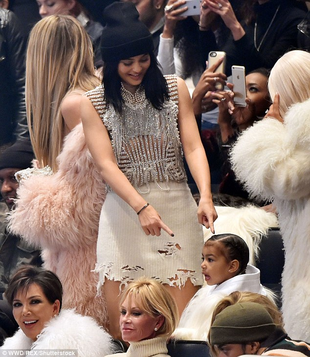 Kylie amusing: Her other aunt could not resist chuckling at Kanye's outlandish designer outfit