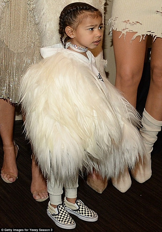 Model-in-waiting: A girl who can pull off a hoodie with furry wings is surely destined for great things