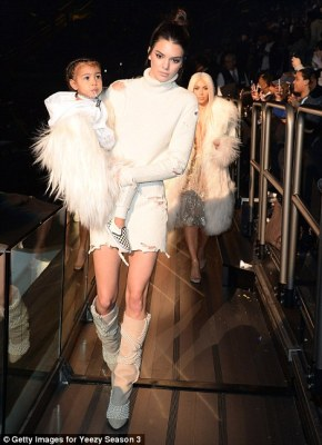 Auntie Kendall: The catwalk star arrived with niece North balanced on her hip
