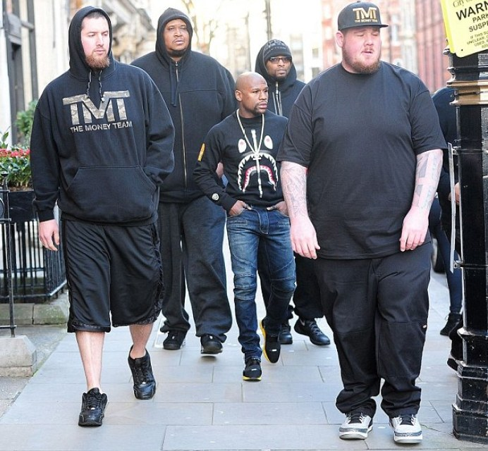 Floyd Mayweather's bodyguards tower over him on luxury shopping spree in London
