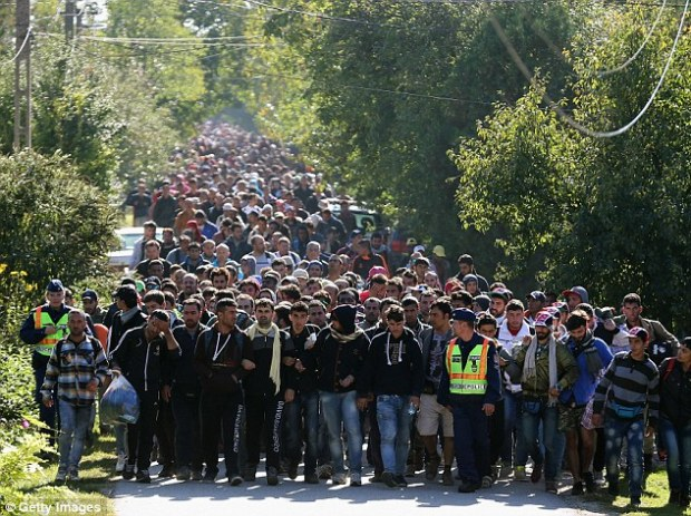 Hundreds of migrants arrived by train on the Hungarian and Austrian border in a stock photograph last year