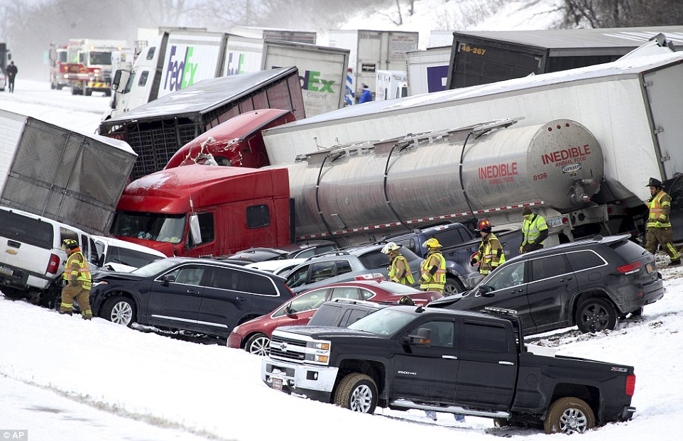 A huge 50-car pile-up shut down a highway near Fredericksburg, Pennsylvania, after a 'total whiteout' and severe winds caused drivers to lose control of their vehicles