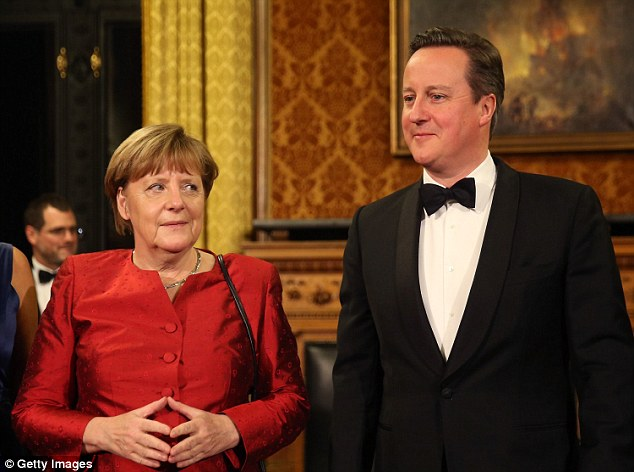 British Prime Minister David Cameron (R) and German Chancellor Angela Merkel attend the annual Matthiae-Mahl dinner at Hamburg City Hall