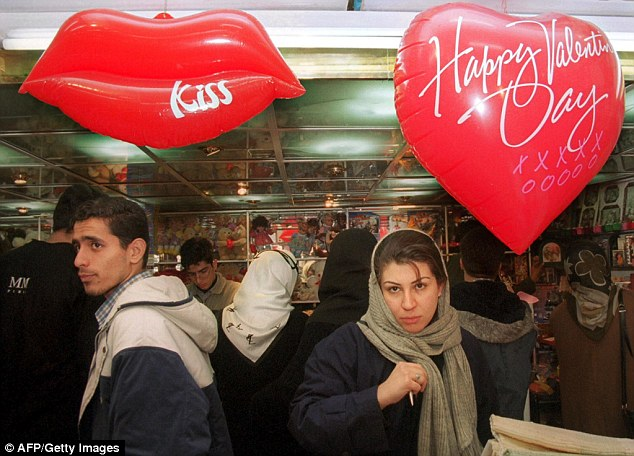 Police told Tehran's coffee and ice cream shops trade union to prevent gatherings in which boys and girls exchange Valentine's Day gifts  (pictured: Iranians shopping for gifts in 2008)