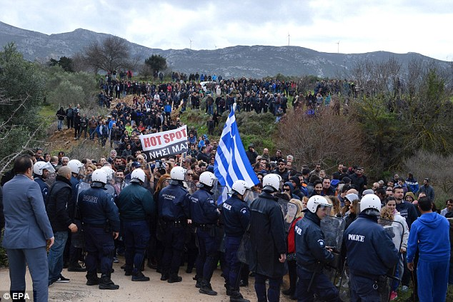 Local media said police fired tear gas to disperse several dozen protesters who tried to break in to the construction site about 10 kilometres (six miles) from the port of Kos