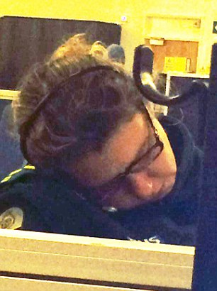 Worn out: The woman paramedic asleep at the Dorset 111 centre