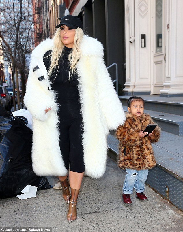 Mama on the go: With daughter North West in NYC on Sunday