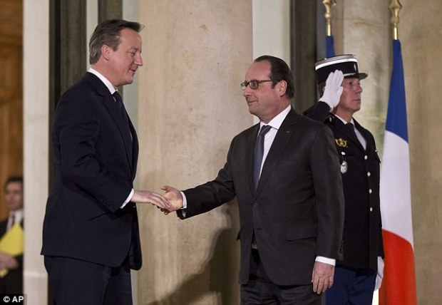 Francois Hollande (right) greets David Cameron in Paris tonight as the PM seeks  to settle differences over Britain's demands for non-euro countries to be given a veto over attempts to strengthen the single currency. But Cameron was dealt a blow today as it emerged MEPs will vote on the UK's deal AFTER the referendum