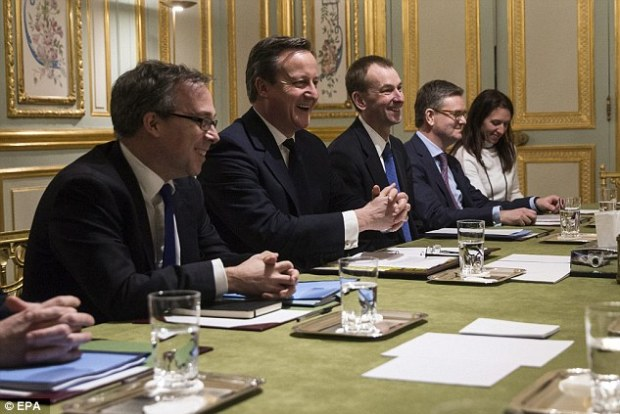 The PM, pictured alongside his aides in Paris tonight, insists the deal reached this week will be 'legally binding' and 'lodged at the United Nations' despite MEPs only debating and voting on the deal after the referendum