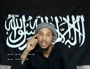 Fanatic: Umar Islam, who is accused of plotting to blow up a passenger jet over the Atlantic, delivers a video message in front of the 'black flag of jihad'