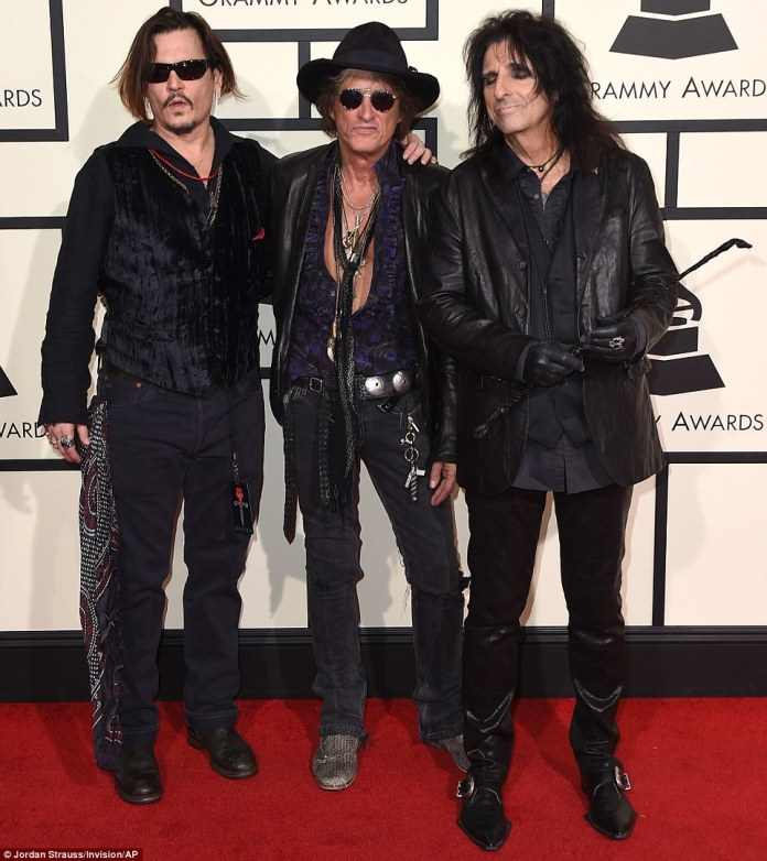 Not your typical Grammys looks: Johnny Depp was joined by his Hollywood Vampire bandmates Alice Cooper (far right) and Joe Perry (C)