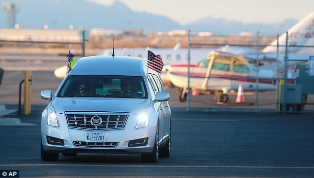The hearse carrying Justice Scalia's body arrives at El Paso Airport on Sunday. His remains were then flown to Virginia.