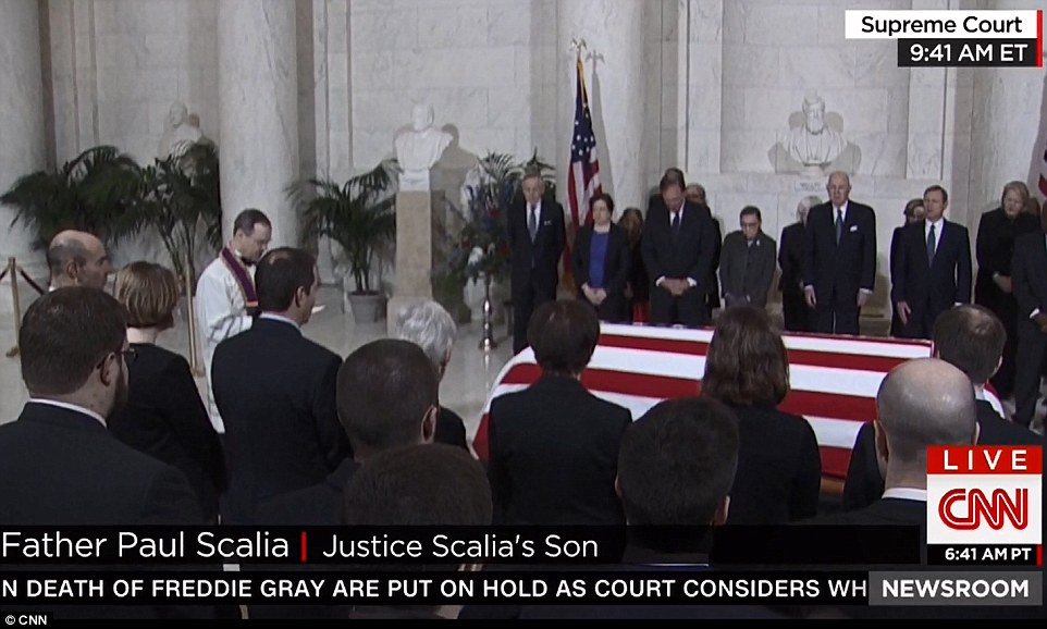 Tributes: Father Paul Scalia, the son of the Supreme Court justice, recited traditional prayers as his father's body arrived at the court