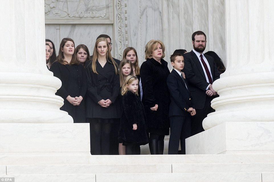 Family members of the late judge watched as eight pallbearers carried the casket of of Justice Scalia into the court this morning