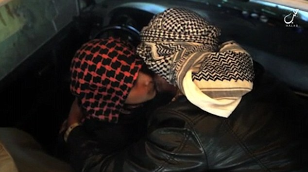 Abu Imara al Omri is seen kissing his father goodbye before blowing himself up in a truck full of explosives