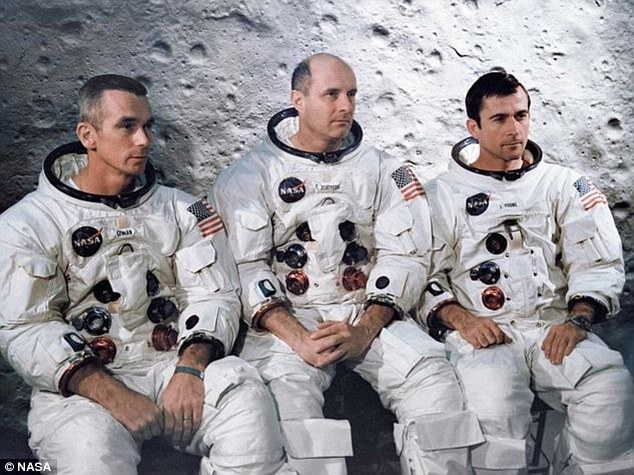 Surprised: The team (pictured left to right: Eugene Cernan, Tom Stafford and John Young) debated whether to tell NASA command about the 'outer space-type music' that they heard