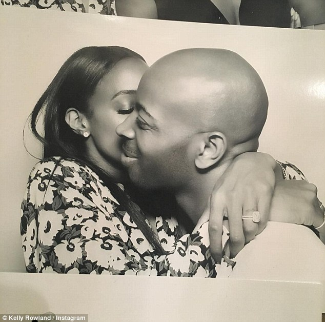 True love: Kelly, who's married to her manager husband Tim Witherspoon, shared a sweet photo of her hubby kissing her on the cheek