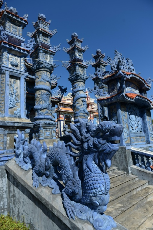While traditional Vietnamese dragon carvings are popular, some graves also appear to draw inspiration from Hindu imagery, with others featuring Christian or ...