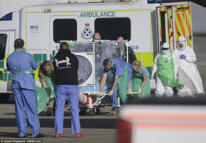 The 39-year-old Scottish health worker (pictured being loaded at Glasgow aiport) was transported to the Royal Free Hospital in London for the third time since contracting Ebola