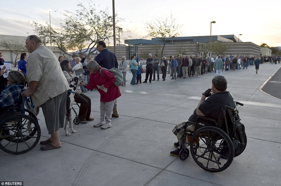 Let the voting begin: People stand in line waiting for the doors to open for the Nevada Republican presidential caucus at Western High School in Las Vegas