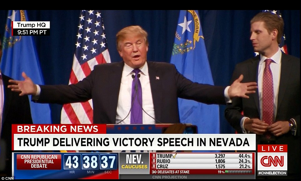 Trump (center, flanked by son Eric) delivers his victory speech live on CNN after he secures the Nevada caucuses with a huge majority,