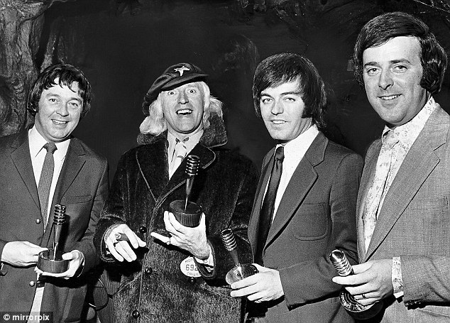 All smiles: Tony Brandon (far left) with (from left to right) Jimmy Saville, Tony Blackburn and Terry Wogan receiving their top DJ awards from the Reveille Newspaper