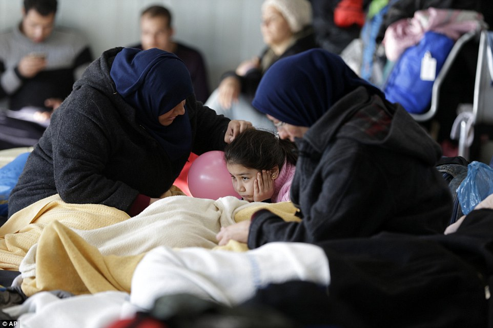 Ministers from non-EU members Serbia, Macedonia and Turkey will also be in Brussels as the European Union reaches outside the borders of the 28-nation bloc in a desperate attempt to deal with the stream of people. Migrants are pictured waiting in Athens, Greece