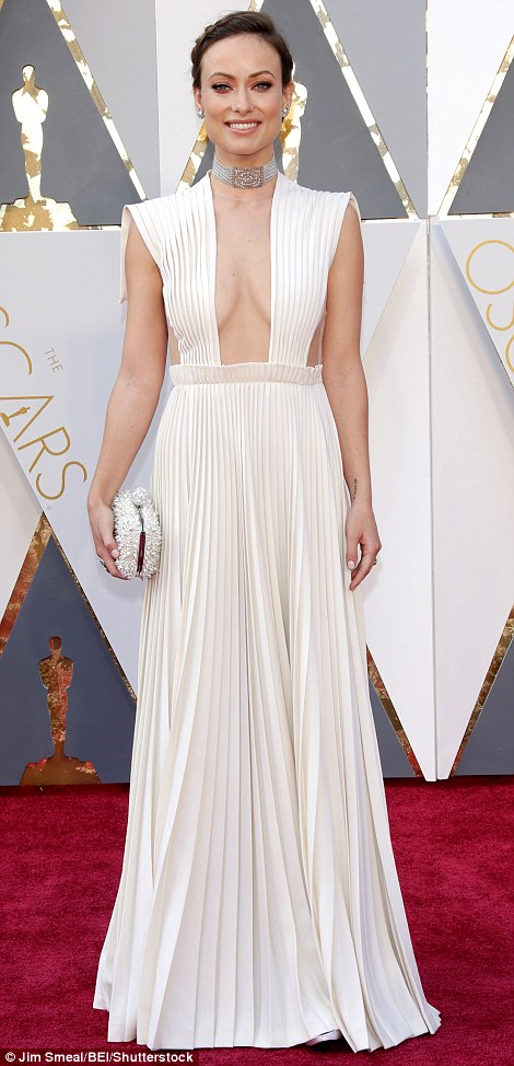 Taking the plunge: Olivia Wilde left little to the imagination in a white pleated Valentino Haute Couture gown with low-cut neckline