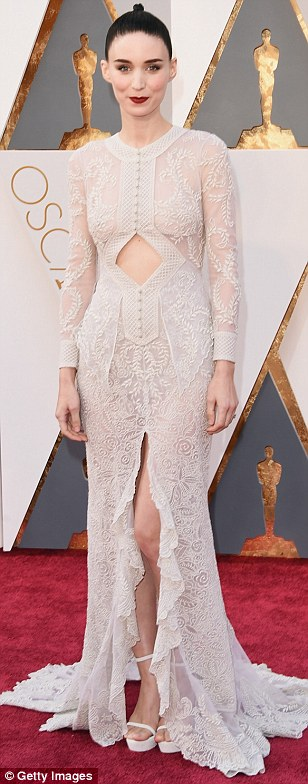 Peekaboo: Rooney Mara picked a delicate off-white lace number by Givenchy, with a diamond cut-out across the stomach