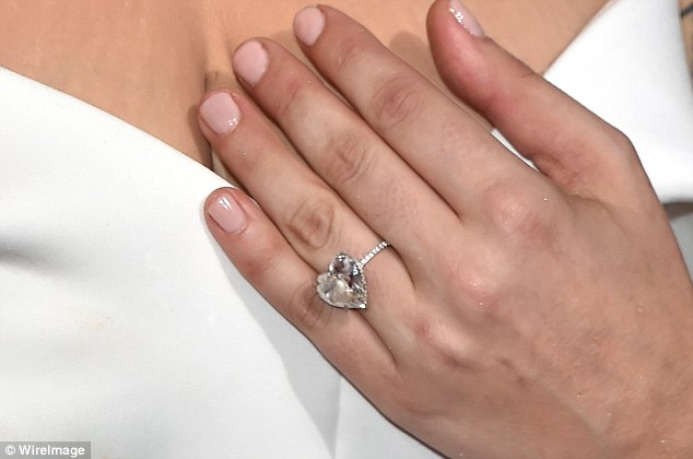 All love: Lady Gaga's engagement ring features a huge heart-shaped diamond