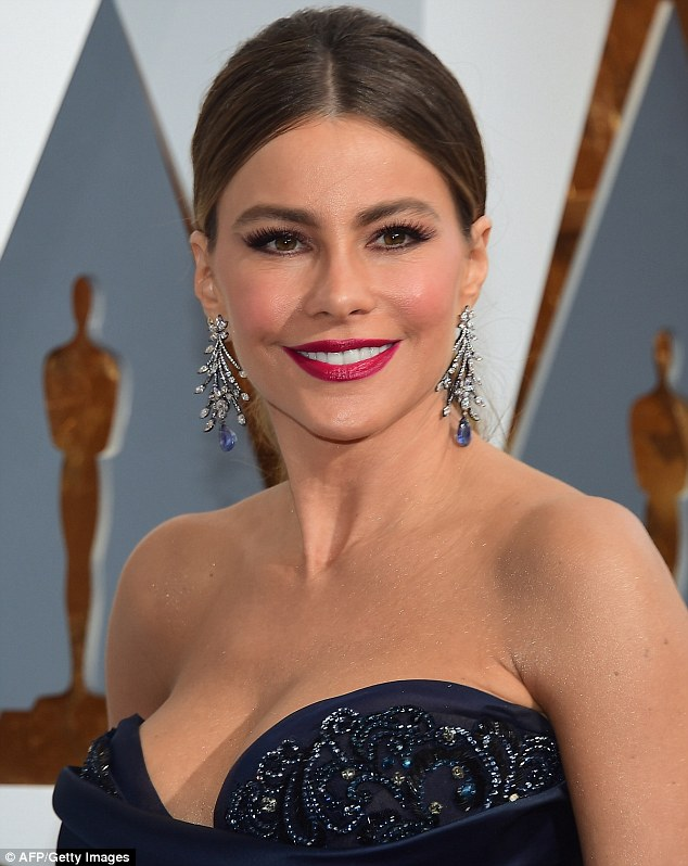 Doing the blues right: Sofia Vergara opted for stunning 65 carat sapphires, which dangled at the end of her diamond-encrusted vine-shaped earrings