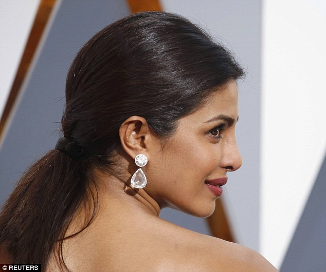 Sleek: The former Miss World complimented the elegant jewels with a simple ponytail and an understated make-up look
