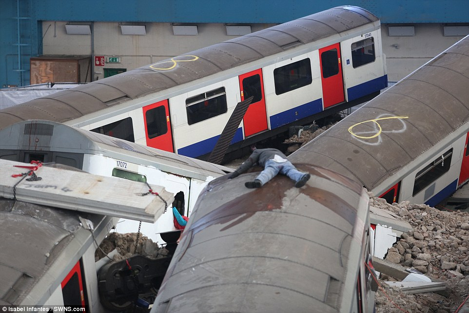 Horror: A 'dead' body lies strewn across the roof of one of the seven Tube carriages involved in the training exercise