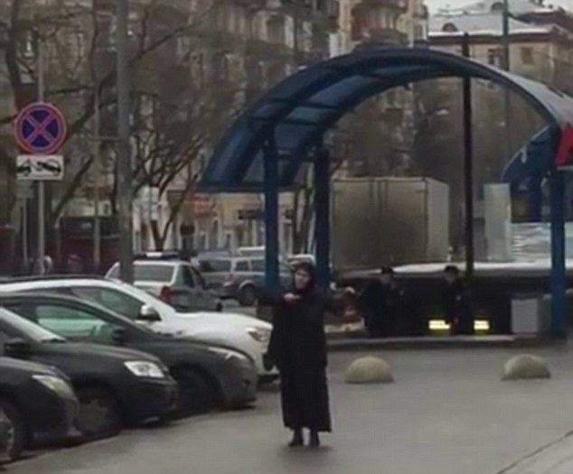 A station in Moscow has been closed amid reports a woman dressed in a black burka was holding the severed head of a child
