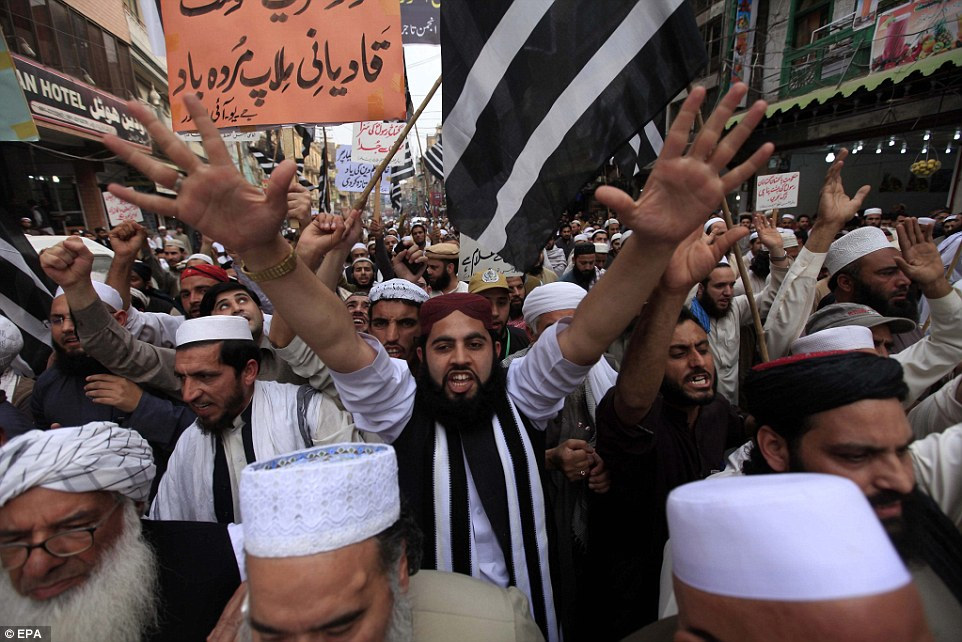 Supporters of the Islamist political party Jamiat Ulema-e-Islam shout slogans during a protest in Peshawar following Qadri's execution