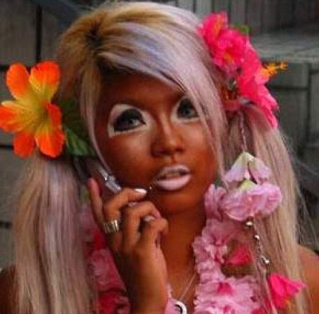 One woman contrasted her peroxide blonde locks with an Oompa Loompa-coloured glow on her face - and white make-up