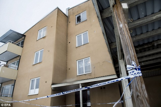 Police tape cordons off the entrance to the asylum seeker accommodation where a 19-year-old was killed