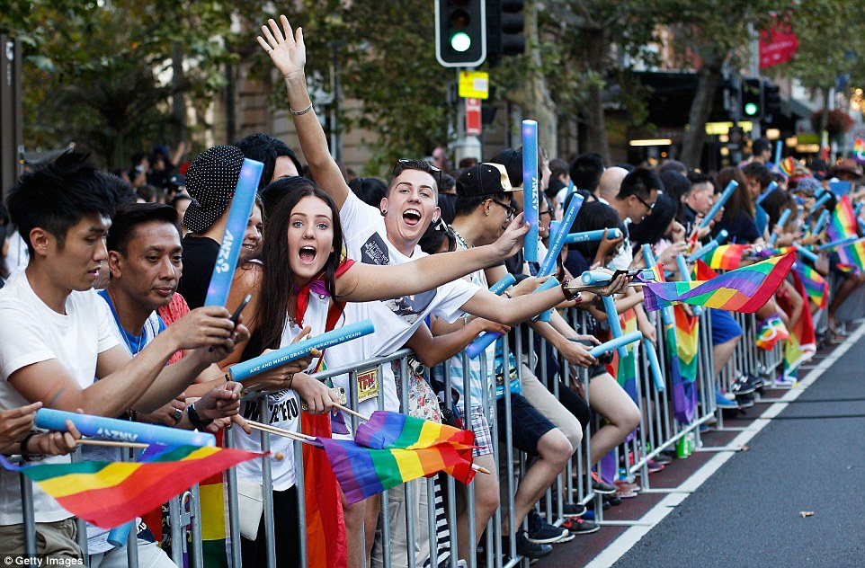Image result for pictures of rainbow clad children at Mardi Gras