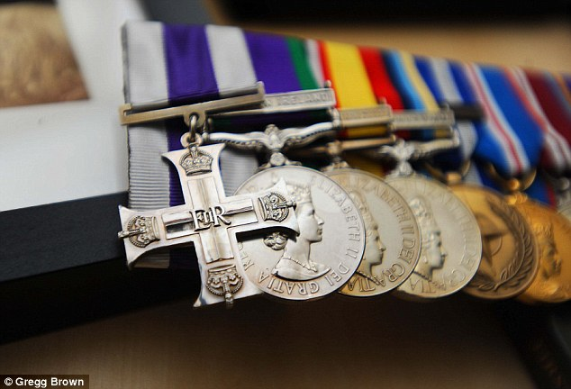 The medals (pictured) Mr Coult is selling include his service medals for fighting in Iraq and Afghanistan and a USA President's Medallion which was presented to him by US president George Bush in 2008