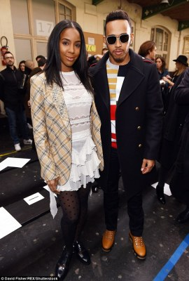Loving the limelight: Kelly Rowland stole the show at the John Galliano presentation on Saturday as she donned a quirky yet eye-catching outfit to join Lewis Hamilton at the John Galliano Paris Fashion Week show