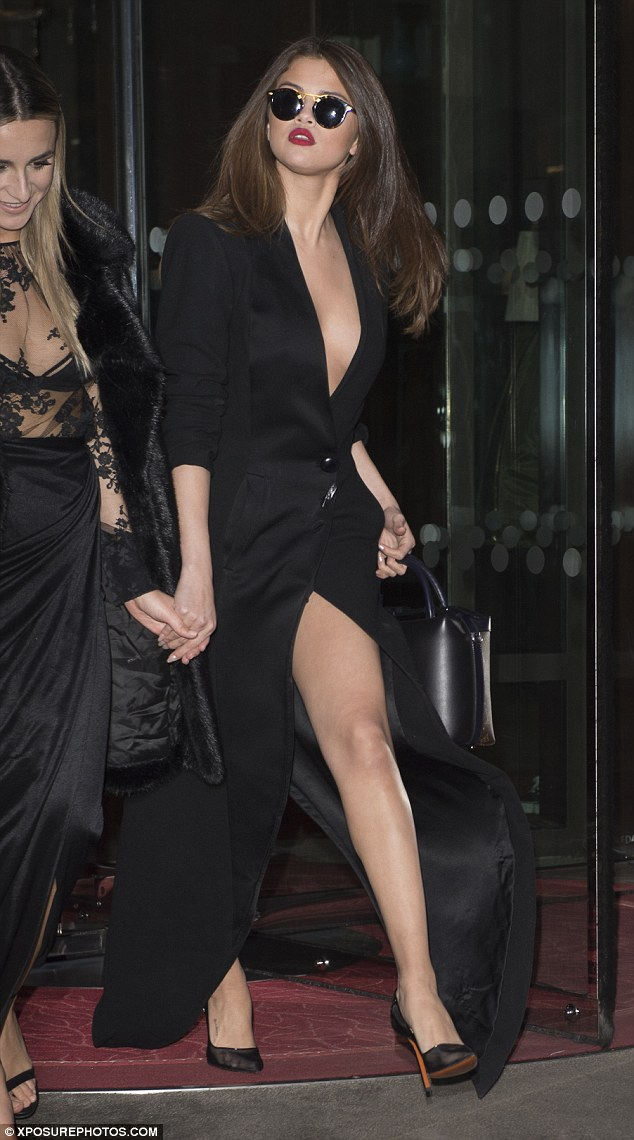 Shady lady: Selena shielded her eyes with Krewe du Optic shades and set off her look with mesh heels