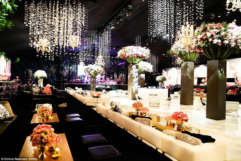 Opulent: Decorations at the party included flowers and butterflies suspended from the ceiling