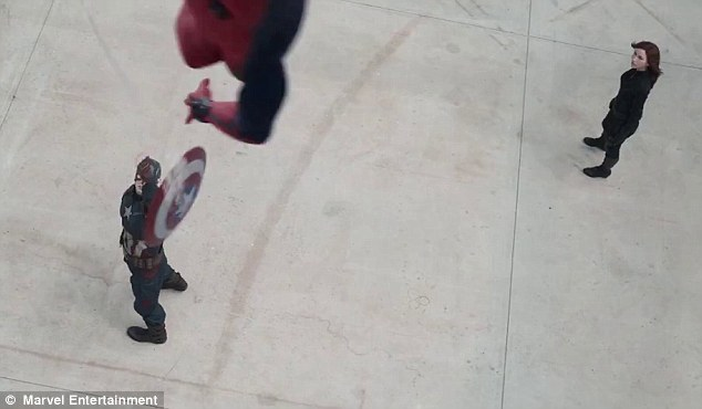 Down came a spider: Suddenly Captain America's shield is snagged from his grasp by web-sling from above