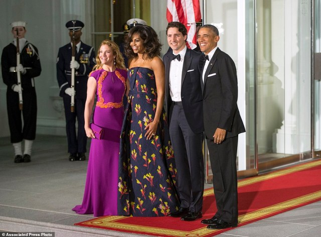 Stunning: Michelle Obama wore a deep blue strapless gown by Jason Wu and Sophie chose a bright purple dress by Canadian designer Lucian Matis