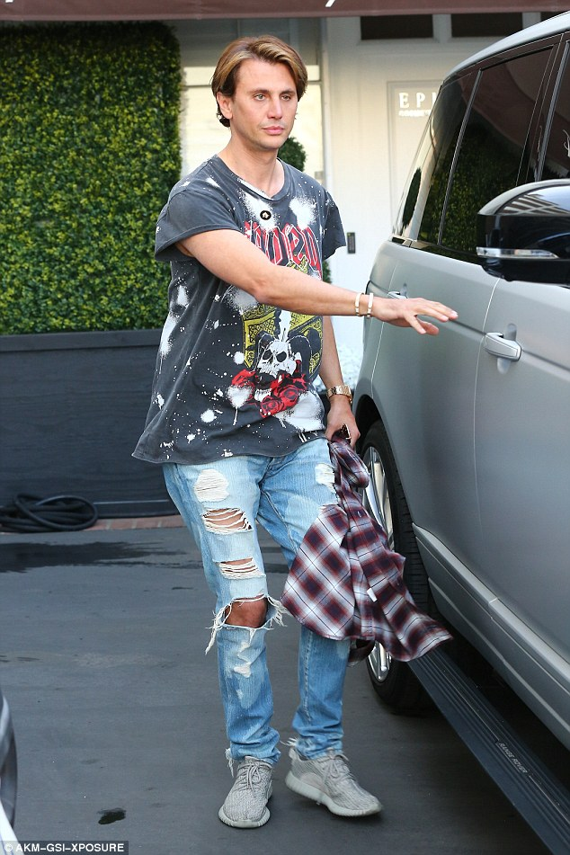 Justin, is that you? For his day of supporting Kim in her errands, the 42-year-old dressed in a pair of ultra-distressed jeans with a bleached vintage-inspired band tee, a flannelette shirt and pair of Kanye's Yeezys