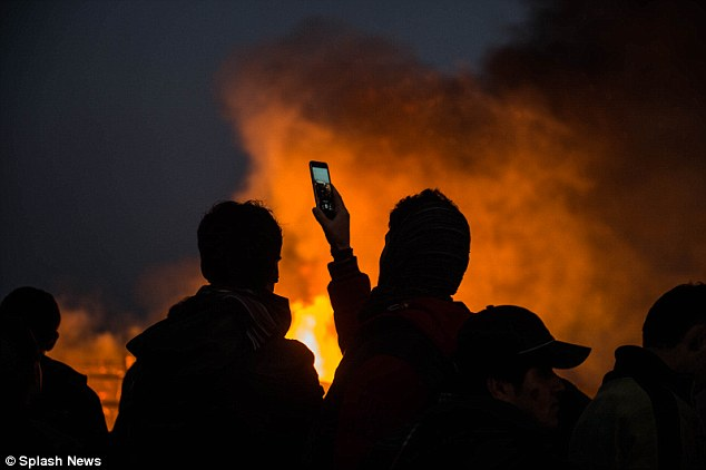 Young migrants were said to be shouting a cheering as the place burned in front of their eyes