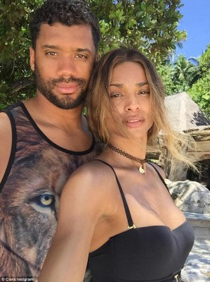 Feeling blissful: Ciara - who gushed about Russell on social media, captioning one of her gorgeous Instagram posts 'You Bring Me Joy' - cuddled up to her new fiance in a striking selfie
