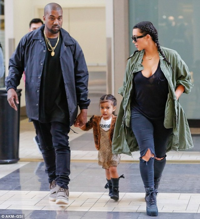 Oh mommy! Kim Kardashian wore a low-cut black top that showed off her chest when she took her daughter out on Sunday