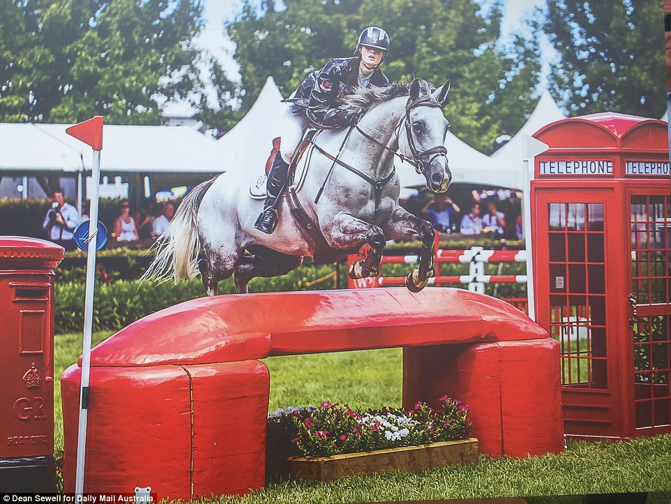 This portrait showed Olivia on the back of a horse leaping over an obstacle while competing in an event